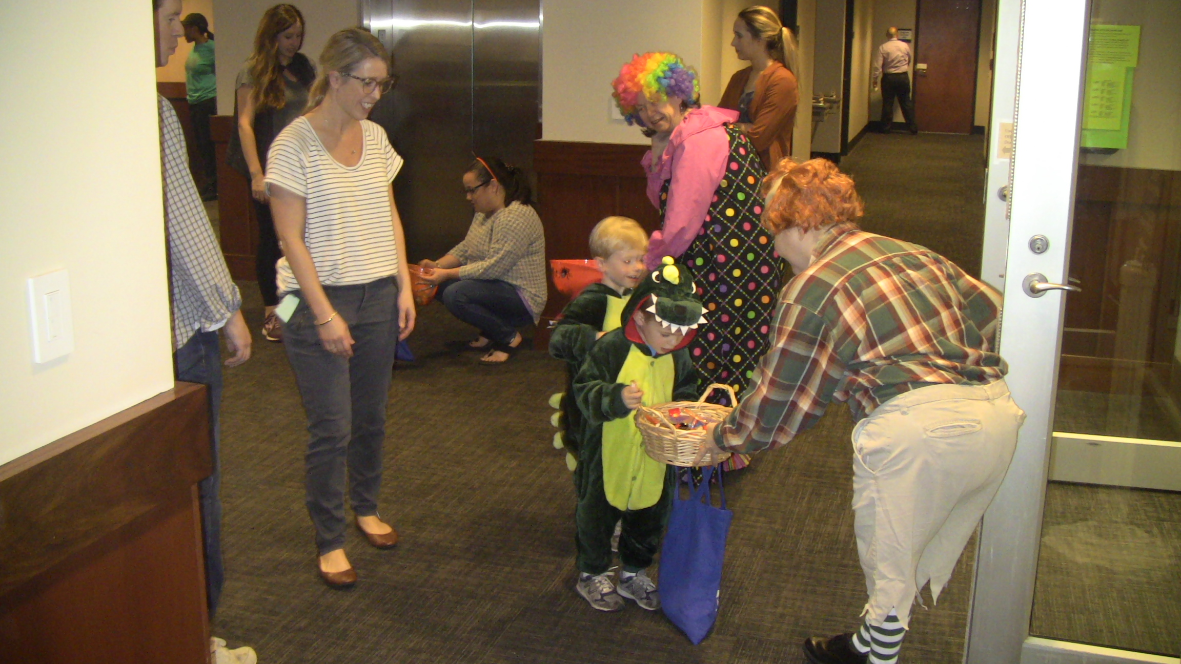Robin Yekaitis dressed up as a lollipop kid from Wizard of Oz, hands out treats during Halloween.