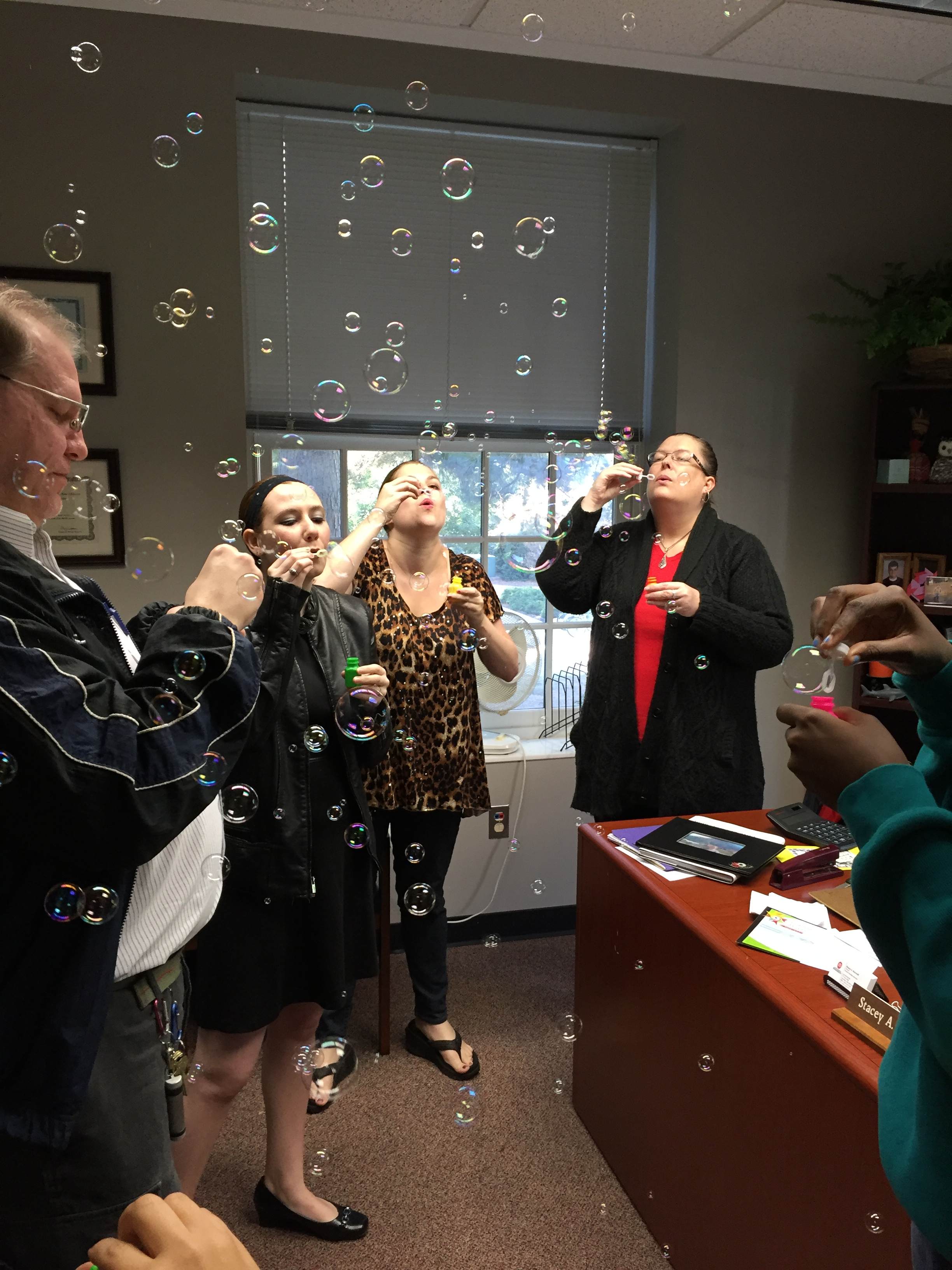 SDS staff members enjoy a fun bubble party.