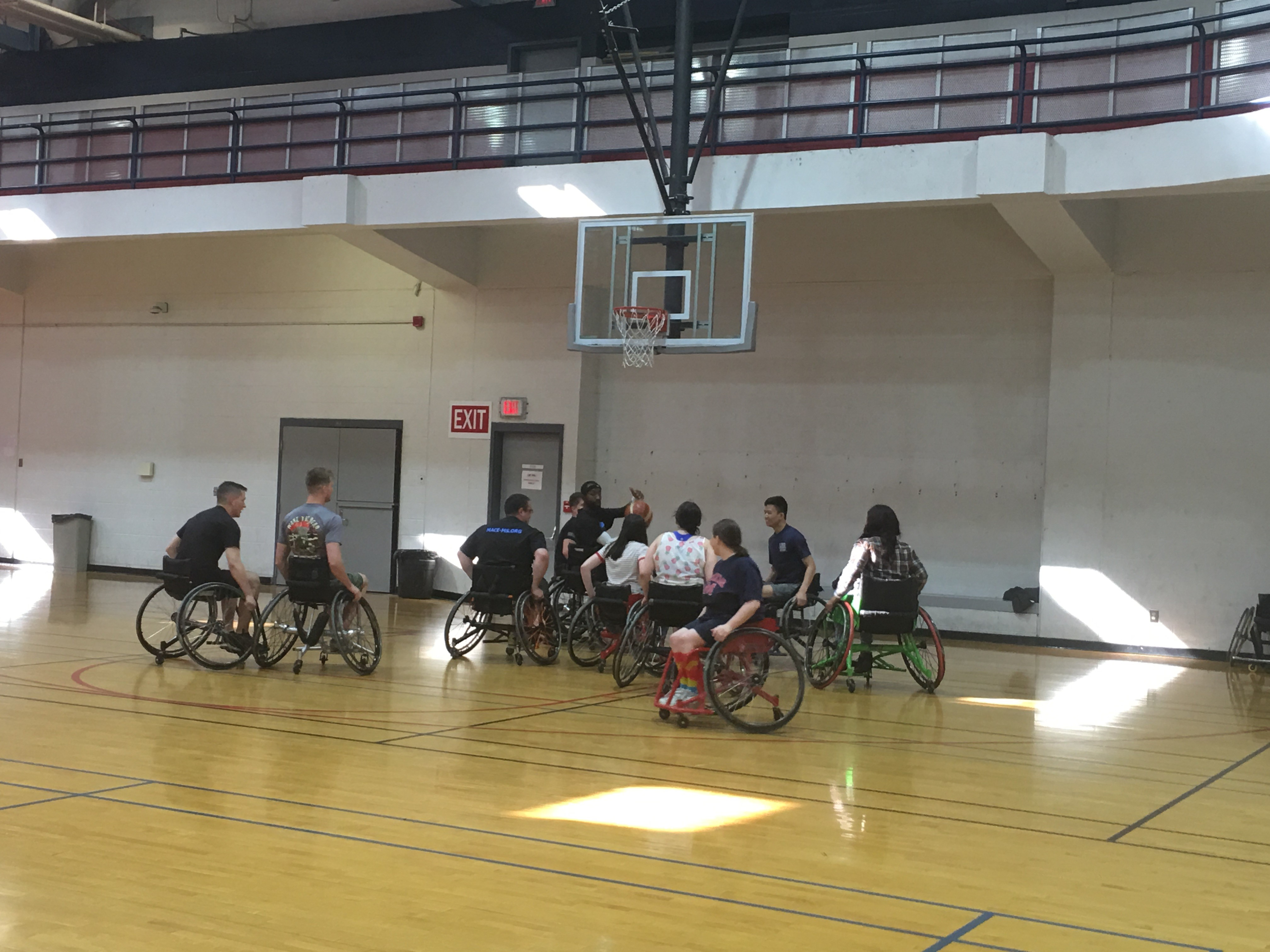 Robin Yekaitis (foreground) plays Wheelchair Basketball during Disability History Month.